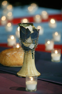 A communion chalice, broken in protest of the United Methodist Church's stance on homosexuality, is returned to the General Conference altar after being mended with wire. A UMNS photo by Mike DuBose. Photo number GC04XXX, 5/7/04